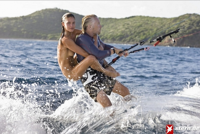 Richard Branson surfing with Denni Parkinson